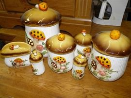 Set of 4 canisters, a salt and pepper shaker, and a napkin holder in pristine condition in the Merry Mushroom pattern, made in Japan Sears and Roebuck.