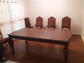 Brand New, Imported, Hand Carved Solid Oak, Vietnamese (8 place  that extends to 12), Dining Set wyith 8 high back hand carved chairs. All  worth $20,999. Price does not include delivery and set up. HIGHEST phone BID takes it. BEST bid so far is $ 900.00. Buy this baby cheap and sell for a major profit later!