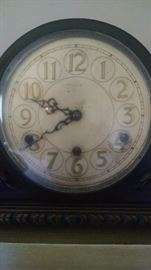 CLOSE-UP..OLD MANTLE CLOCK...