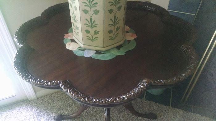 CLOSE-UP....ORNATE PIE-CRUST TABLE