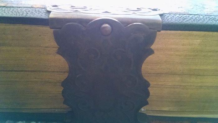 CLOSE-UP...METAL LATCH / BIBLE
