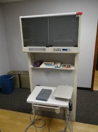 A Dec Double Sided Stand and Pull Out Work Station.