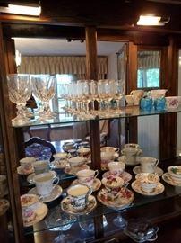 nice selection of tea cups and crystal