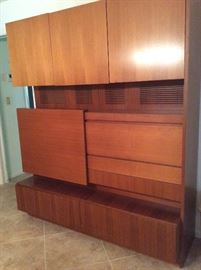 "Mid-century Danish teak Wall Unit with sliding panel. Measures 66""w x 74""h x 22""d"