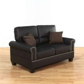 """BOYSTER"" BLACK FAUX LEATHER LOVESEAT W/ NAILHEAD TRIM"