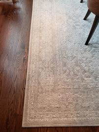 Gorgeous Area Rug. Size : 9'2 x 12'9 Champagne/ gray tones / New condition. Originally paid close to $900. Selling for- $400