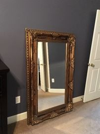 Large gold tone framed mirror.