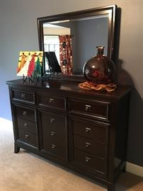 Beautiful dark cherry 9 drawer dresser and mirror.