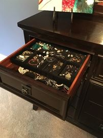 Beautiful dark cherry 9 drawer dresser and mirror. Two end top drawers have built in velvet jewelry holders.