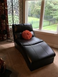 Pleather chaise/lounge chair by Ashley furniture, in excellent condition. Black.