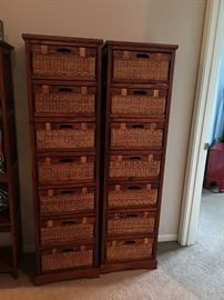 2 wood shelving units with wicker and wood baskets. Approx 5 1/2 feet tall.