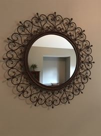 "Cute metal framed mirror, 24"" round."