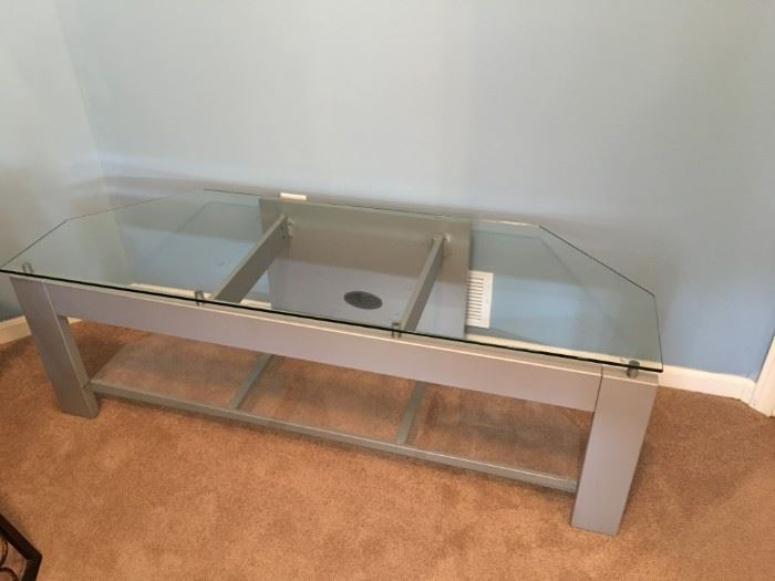 "Metal and glass TV stand. 58""w X 20""d X 19""t"