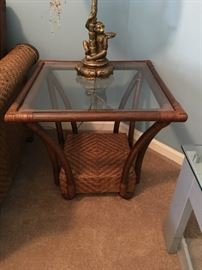Pretty bamboo and wicker, glass top end table.