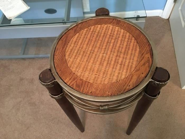 Wood, metal and wicker accent table.