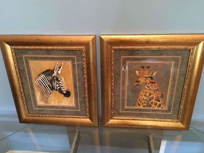 Gorgeous framed zebra and giraffe prints.