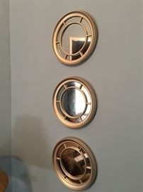 Three small framed mirrors.