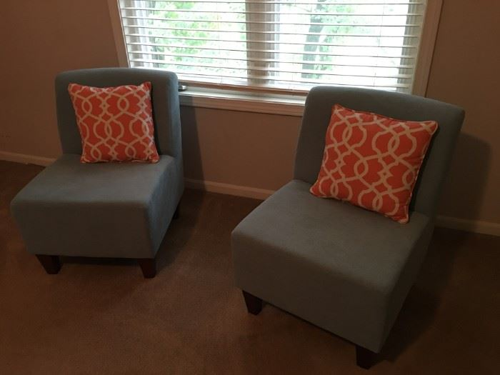 Two very cute light blue upholstered chairs.