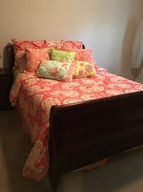 Queen sleigh bed, linens and mattress & box.
