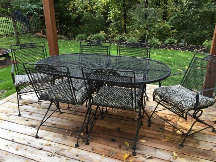 Wrought iron patio table and 6 rocker chairs in excellent condition!