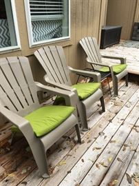 Three Adirondack chairs w/cushions.