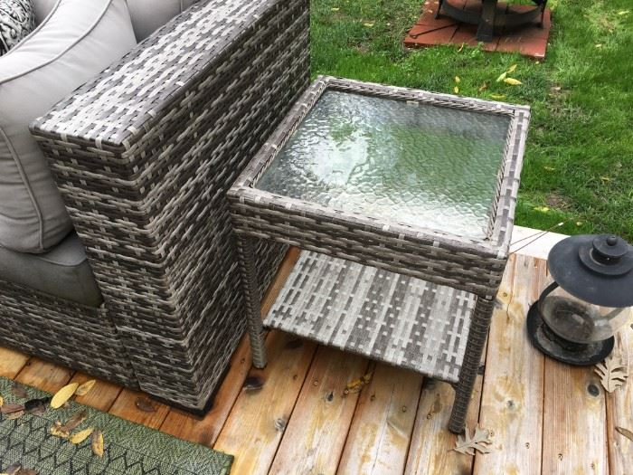 Grey, outdoor wicker sofa and ottoman in beautiful condition, with glass top side table.