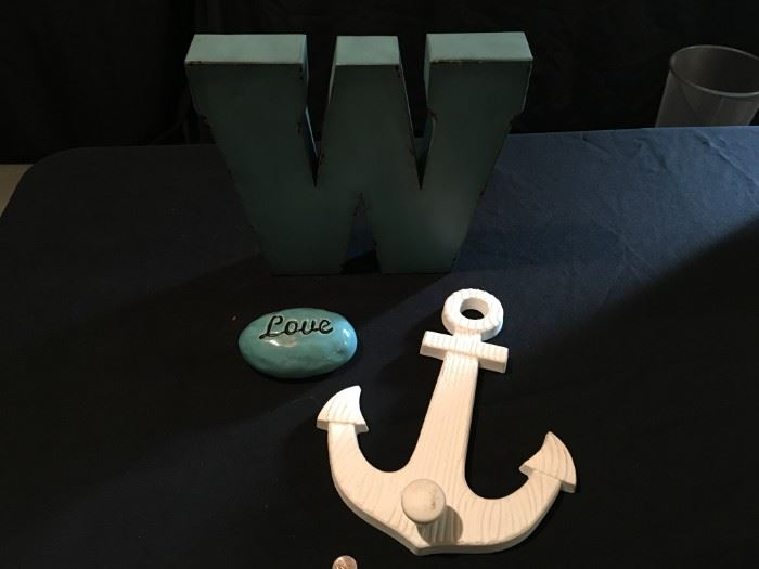 "Metal ""W"", wood anchor and ceramic ""love"" stone."