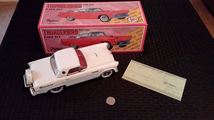 1956 Thunderbird hard top die cast car with box and certificate.