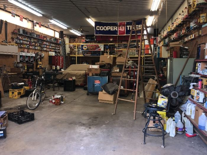 An entire barn full of cars, auto parts, oil cans, tools and so much more!!