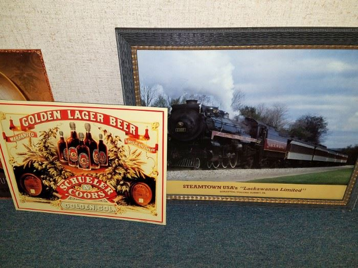 Tin advertising signage. Framed train art