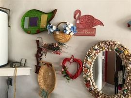 Misc. wall decorations including a shell mirror