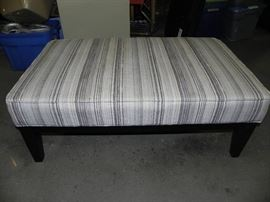 Good looking striped ottoman