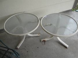 2 Outdoor small tables metal base glass top.