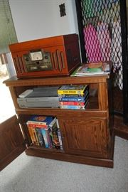 Tv cabinet, collection of VHS and Crosley combination player - radio, CD, record