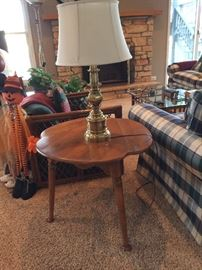 Tri leg Maple table folds down to triangle shape