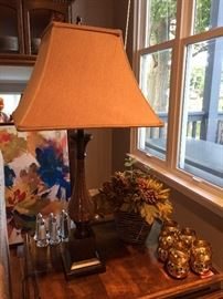 Home decor lamps, napkin rings and floral arrangements