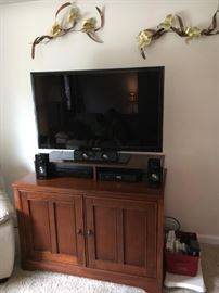 Samsung tv, blu ray dvr and surround sound.  Tv cabinet and riser.  Each priced on own.
