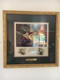 Set of 2 Thomas Kinkade framed prints.