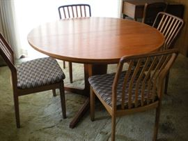 House of Denmark Dining table and 4 chairs, with two leaves for the table. Chairs newly reupholstered.