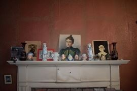 Antique Figurines, Portraits, Prints, and Vases adorn this original fireplace mantle from this fine home built in 1815