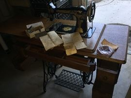 1918 Singer Sewing Machince with Treadle cabinet.  Viewing some of the extra's coming with the sale of this package.
