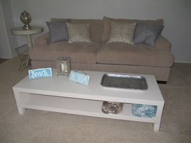 White laminate coffee table, decorative pillows