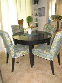 Round dining table with slip covered chairs