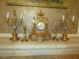 Antique french gilt mantel clock with garnitures