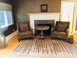 Uttermost luxe leather dark brown armchairs with nailhead trim.