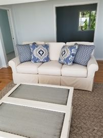 sleeper couch 80Wx39Dx31.5H $2,000.  Off white cotton duck slipcover. Separate cushion seats and backs