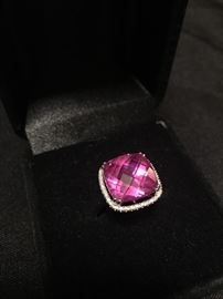 Pink tourmaline with diamond halo set in 14 K gold