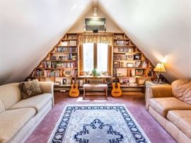 Acoustic guitars , bench &  a library of books