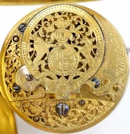 "John Hill Verge with Royal Coat of Arms - John Hill ( Son of Benjamin Hill), London, 18th century.  This watch has a pierced engraved balance cock with the British Royal Coat of Arms (Post 1702 Unification) and Filigree chain guard with Queen Anne's Royal monogram.  54mm Gilded case with Basket weave design.  Fusee verge movement KW (through dial), KS, with Egyptian pillars, marked ""Jn Hill, London"", having a flat porcelain dial with Roman numerals.  Some wear, inset monogram on rear cover, light hairlines and repairs to dial.  Winds, sets and running when cataloged."