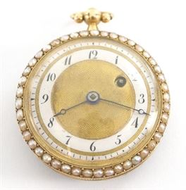 A French 18k Gold ladies pendant watch with seed Pearl bezels and enameled rear cover.  35mm, KW (through the dial), KS, 18k Yellow Gold, OF, Gold engine turned dial w/Arabic numerals on a porcelain chapter ring.  Serial # 27794.  26.1 grams total weight.  Some wear, lacks one pearl on rear cover.  Winds, and sets, not running when cataloged.